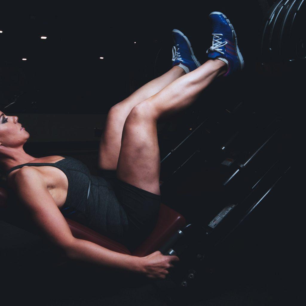 woman using leg press